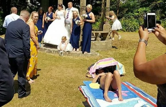 Brazen sunbather ruins couple's wedding photos by refusing to move