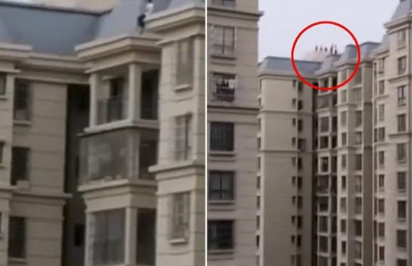 Boy sits on the edge of the rooftop of a 33-STOREY building