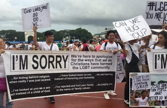 Christians turn up at gay pride march with huge 'I'm Sorry' banner