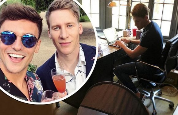 Dustin Lance Black looks takes newborn son Robert Ray to work