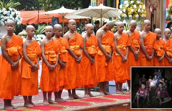Rescued thai cave boys pose in robes as they become novice monks