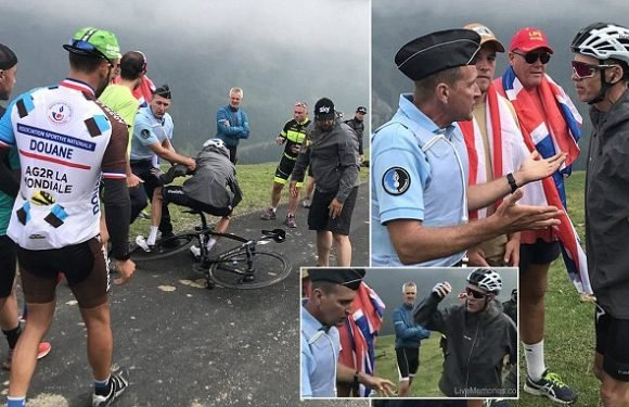 Police officer causes Froome to crash after mistaking him for a fan