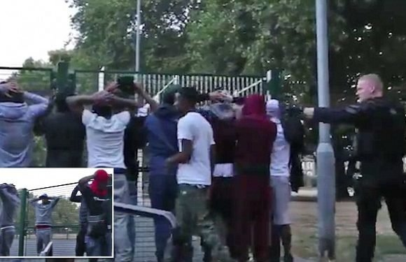 Armed police interrupt masked 'rappers' filming Drill music video
