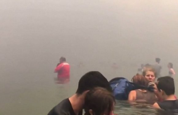 Shocking footage shows people take to the sea to avoid Greek wildfires