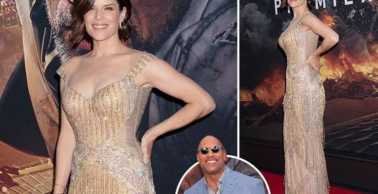 Neve Campbell glitters in a gold gown as she joins Dwayne 'The Rock' Johnson at Skyscraper premiere in New York