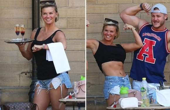 Kerry Katona drinks bottles of bubbly and flexes her muscles with Austin Armacost during fun day out in Bradford
