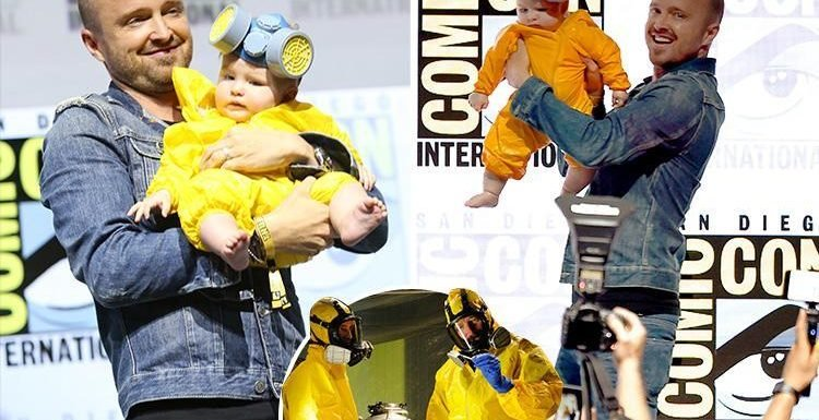 Aaron Paul dresses baby daughter Story in a tiny version of his Breaking Bad hazmat suit for reunion with Bryan Cranston