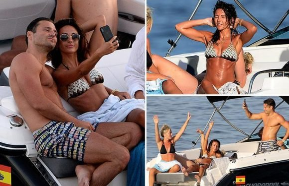 Michelle Keegan wows in a bikini as she cuddles up to husband Mark Wright as they set sail on holiday in Spain