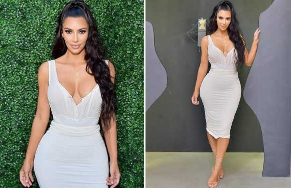 Kim Kardashian wows fans in figure hugging white dress at her beauty launch