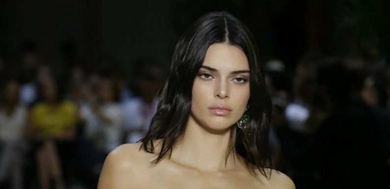 Kendall Jenner Looks Casual Rocking Snoop Dogg Shirt At Airport