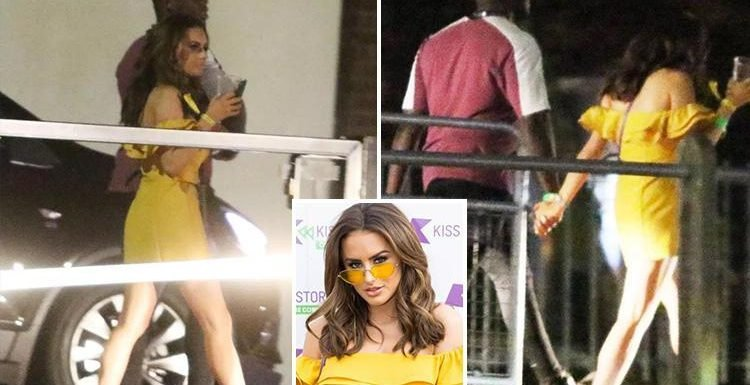 Love Island winner Amber Davies pictured leaving music festival hand in hand with co-star Marcel Somerville's friend