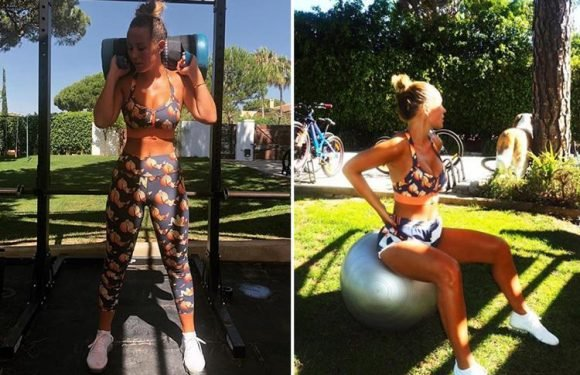 Kate Wright shows off her abs as she gets stuck into a morning workout in a crop top and matching leggings