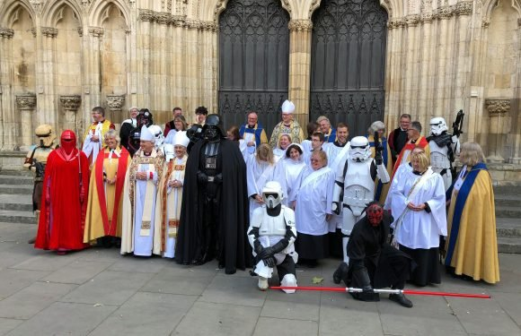 Star Wars baddies join light side as they pose with priests and choristers
