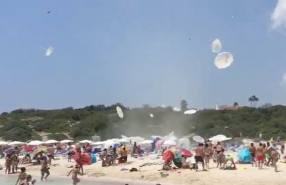 Whirlwind causes panic as holidaymakers dodge parasols on beach
