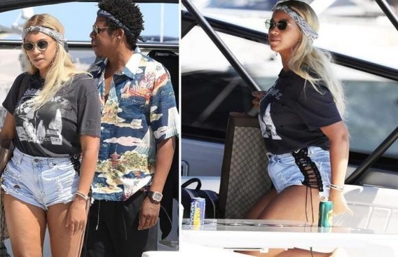 Beyonce covers up in a baggy T-Shirt and denim hot pants as she sails into Nice with Jay-Z amid growing pregnancy rumours