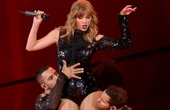 Taylor Swift Realizes She Reaches For 'Invisible Things' In Black Sparkly One Piece