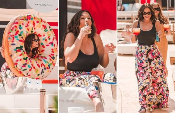 Vicky Pattison poses in a giant doughnut as she parties with holidaymakers in Majorca