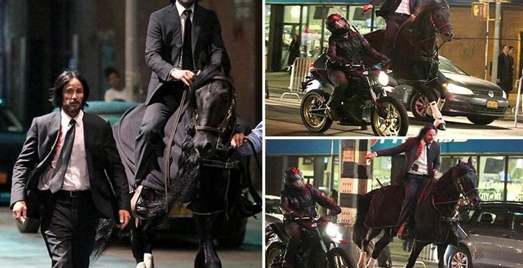 Keanu Reeves horses around with his stunt double on the set of John Wick 3