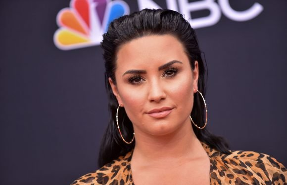 Demi Lovato awake and with family after suspected heroin overdose