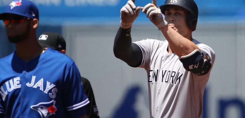 Shorthanded Yankees find another way to escape with win