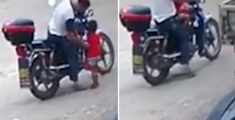 Chilling moment girl, 3, is snatched by 'child trafficker' and driven away on a motorbike in front of her dad
