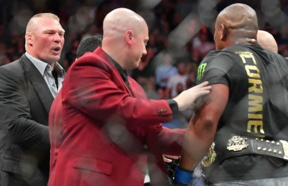 In WWE Fashion, At 'UFC 226,' Brock Lesnar Storms In And Confronts Daniel Cormier, 'I'm Coming For You'
