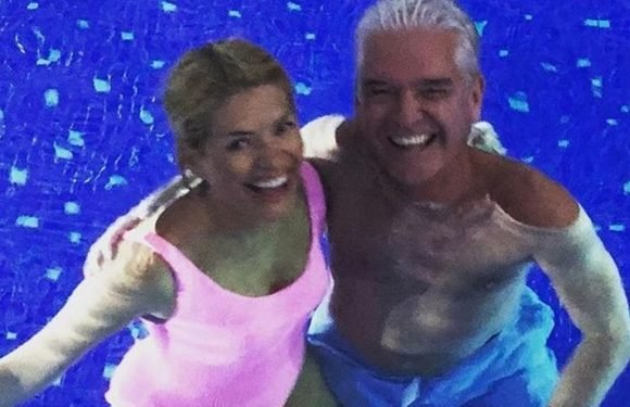 Holly Willoughby and Phillip Schofield snuggle up in their swimwear