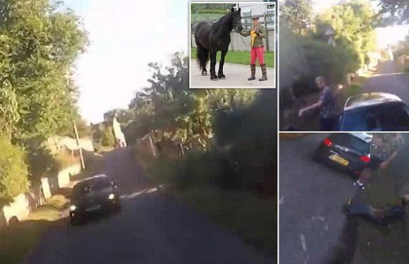 Shocking moment driver ploughs into horse-riding couple