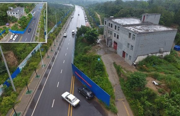 Defiant Chinese 'nail house' owner refuses to budge, blocking traffic
