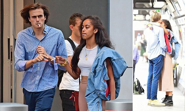 Malia pictured snuggling her beau in a London underground station