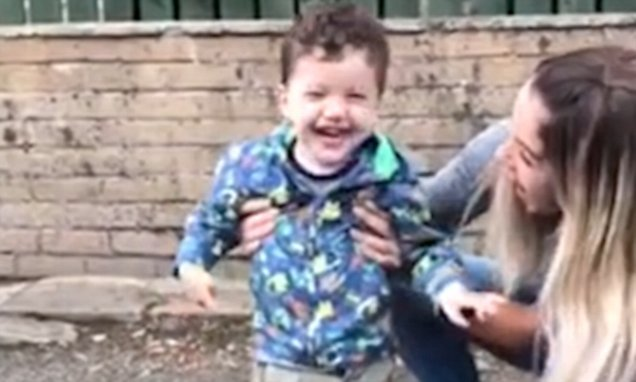 Two-year-old with cerebral palsy splashes in a puddle for first time