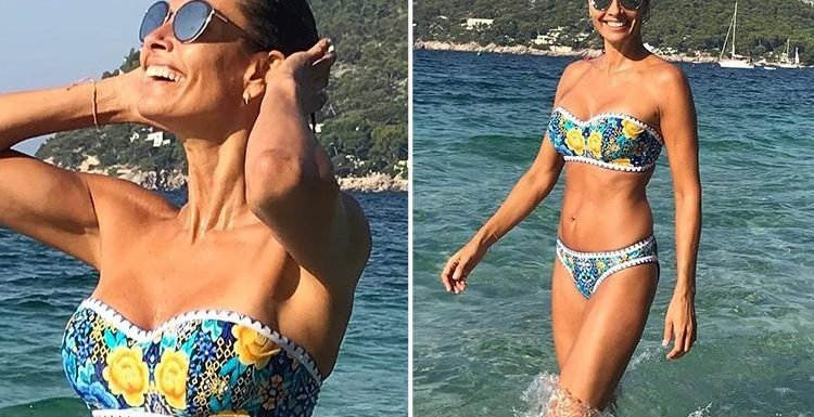 Mel Sykes celebrates her 48th birthday in a strapless bikini on holiday in Mallorca