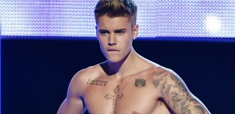Justin Bieber Shows Off Toned And Tatted Body During NYC Outing