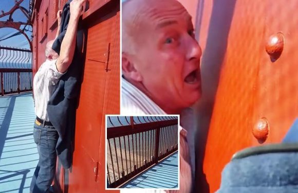 Moment pensioner who is scared of heights clings on in fear at top of Blackpool Tower