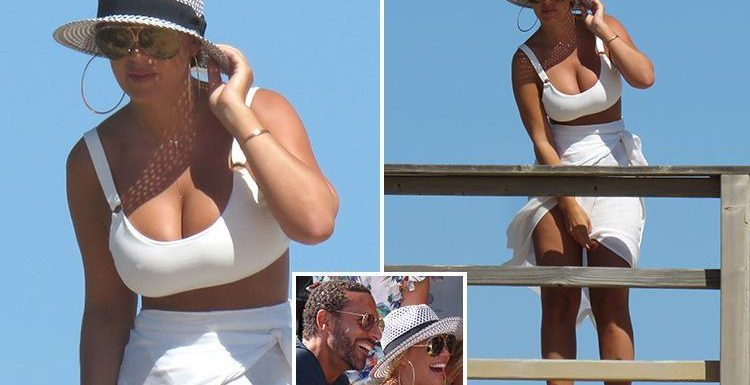 Kate Wright looks sensational in a plunging crop top as she's spotted on the beach in Portugal with Rio Ferdinand