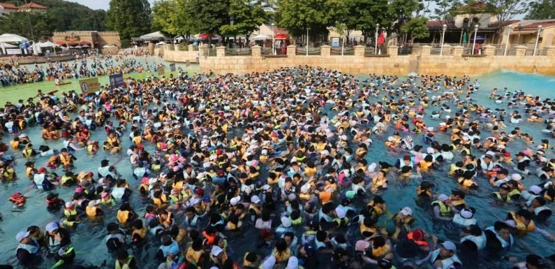 Grim scenes as hundreds of sweltering Koreans pack themselves into public pools in a desperate bid to escape heatwave engulfing the planet