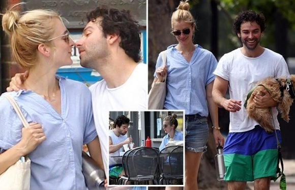 Aidan Turner kisses girlfriend Caitlin Fitzgerald before they grab fish and chips in London