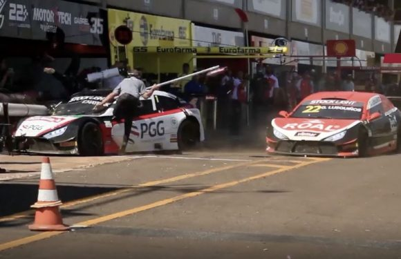 Race car crash smashes into pit lane with crew members thrown into air