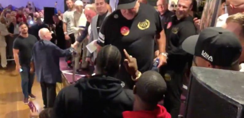 Tyson Fury's dad has to be restrained after confronting Deontay Wilder