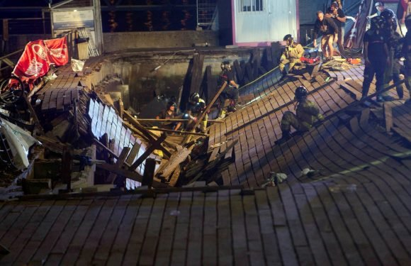 Hundreds injured after music festival pier collapses into sea