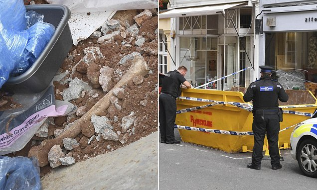 Skip in city centre is cordoned off after 'human bones' discovered