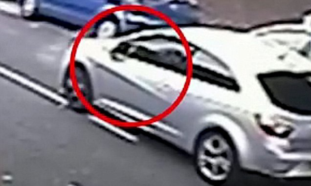 Moment gunmen fires at car in drive-by shooting on residential street