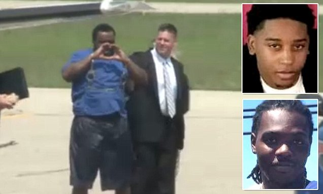 FBI's Most Wanted fugitive charged in double murder dances for cameras