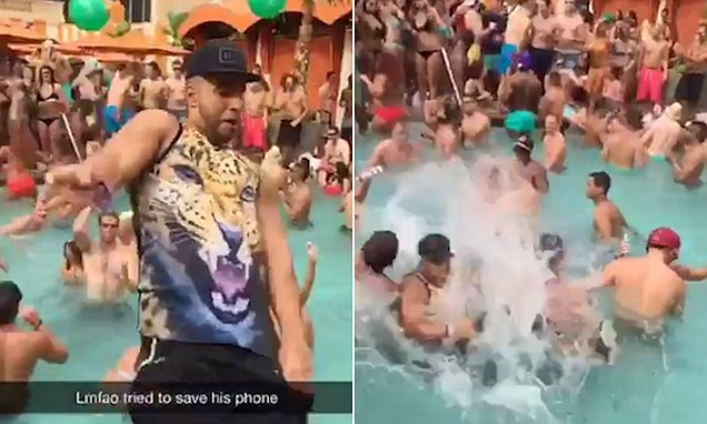 Hilarious moment dancing man falls into the swimming pool