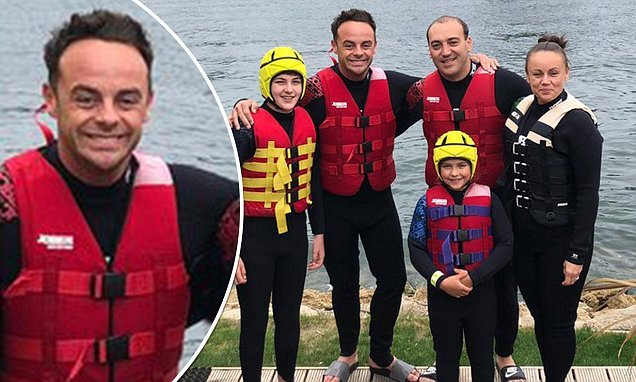 Ant McPartlin looks elated as he enjoys a family day out at water park