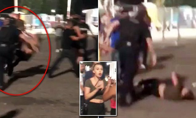 Shocking moment a Canadian cop knocks woman to the ground