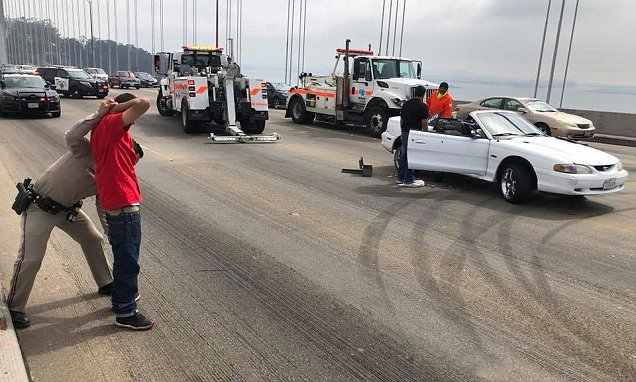 Traffic on Bay Bridge grinds to a halt as sports cars perform donuts