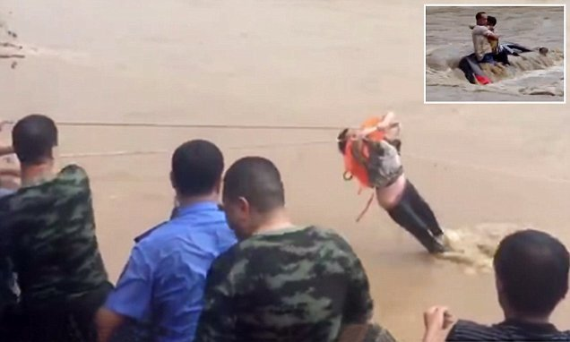 Couple stranded in floodwaters saved by firefighters using zip line
