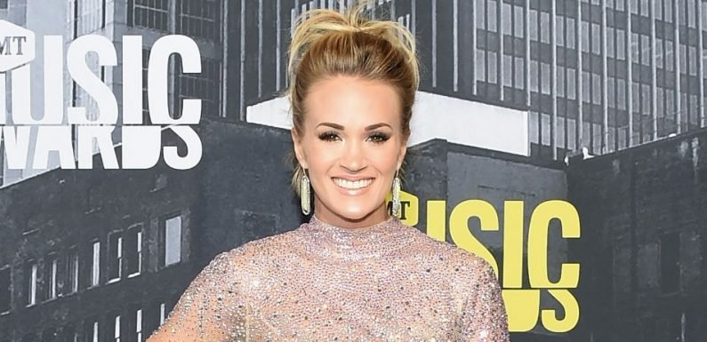 Carrie Underwood Sports Leather Playsuit, Reveals New 'Sunday Night Football' Song In New Video