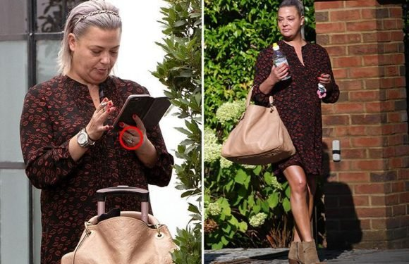 Lisa Armstrong is STILL wearing her diamond engagement ring as she relaxes with a cigarette outside the Strictly rehearsal rooms